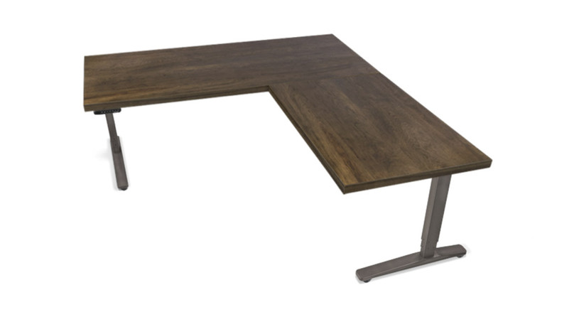 The UPLIFT Adjustable L-Shape Custom Solid Wood Standing Desk is ready to give your office the extra space it needs