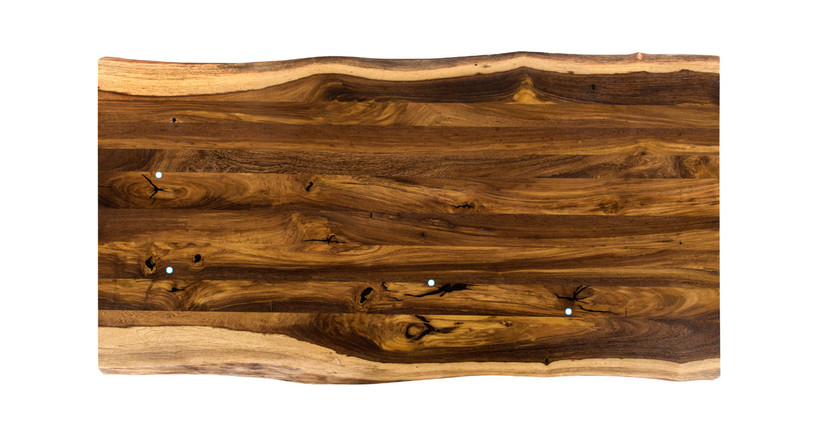 As each desktop is 100% unique, you should expect the possibility of some black wood filler appearing in our pheasantwood desktops.  Here is an example of what one might receive.