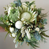White King Protea - Seasonal flowers include disbuds, spray roses, andromeder, queen annes lace and gum foliage