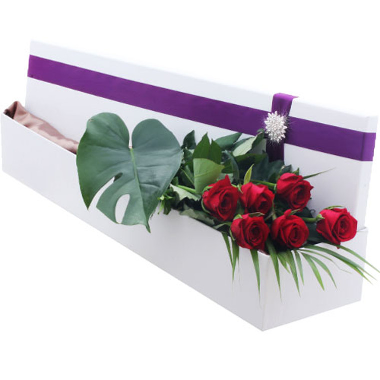 Half a Dozen roses displayed in our signature silk lined Hollywood box and finished with a diamante buckle