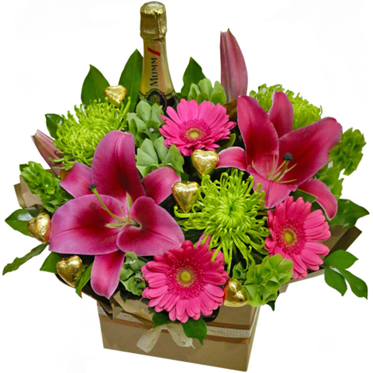 Bright Arrangement of flowers and bottle of GH Mumm Champagne