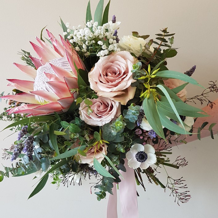 Pink King Protea - Seasonal flowers include anenome, roses,. baby's breath, ranuncula, lavender and gum foliage