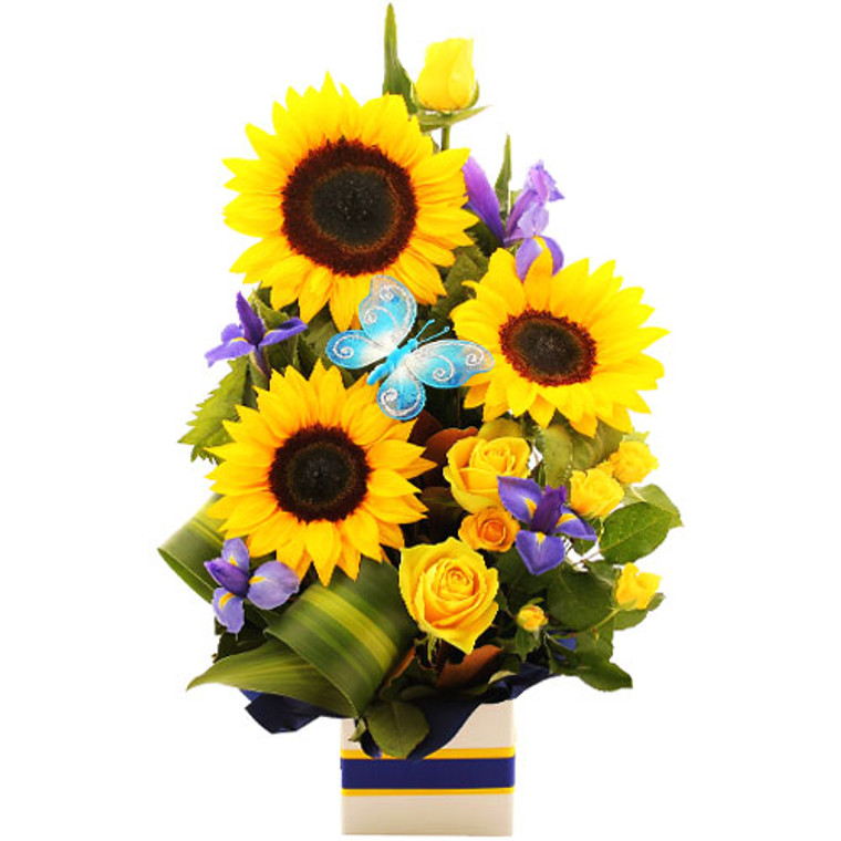 Bright Sunflowers, Roses and Iris in a box arrangement with a pretty butterfly