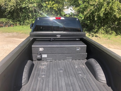 52 Gallon Aluminum Auxiliary Fuel Tank and Toolbox Combination Designed for use with a Roll-Top Bed Cover. Made by: Aluminum Tank & Tank Accessories, Inc. 1-800-773-3047. **Shown with the optional Spray-on Bedliner.