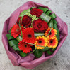 A grouped posy of Roses and Gerberas with folded foliage