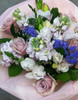 Pale pink with a touch of lavender incs stock, freesias and roses, based on our best seller lambton with seasonal foliage.