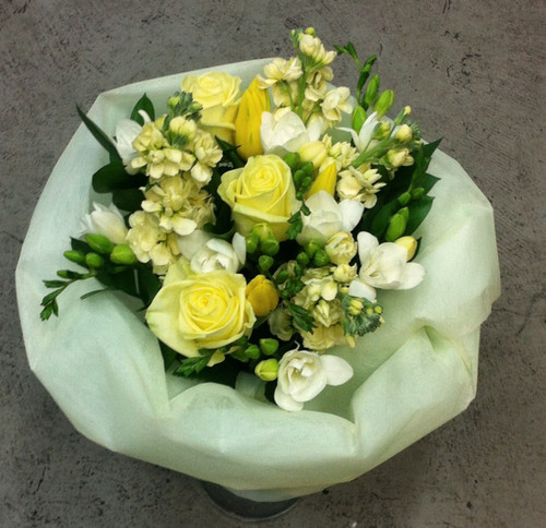 "A lemon and white bouquet based on our best seller ""lambton"" include freesias, roses and stock"