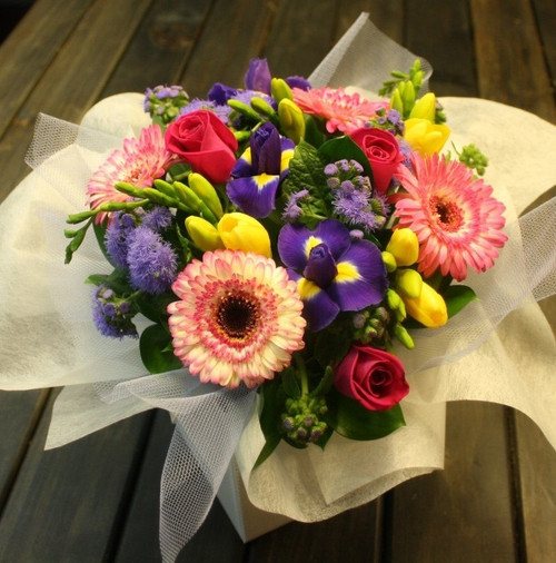 Bright Yellows, pinks and purples in a box arrangement.