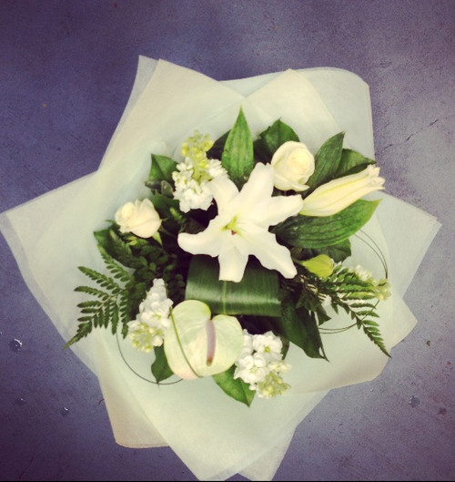 Bouquet of Seasonal whites and greens flowers. Perfect bouquet for a sympathy or for someone who likes something simple and classic.