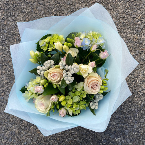 Crisp seasonal bouquet in fresh whites, greens and pale pinks.
