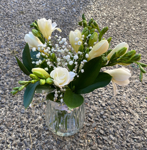 Petite posy of freesia's in a vintage styled vase.