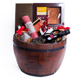 A classic oak barrel basket that includes the classic pairings of fine cognac, extra virgin olive oil, maple glazed salmon and many more items. Gift Includes: • Half Wine Barrel • Baron Otard VSOP Cognac • Brix Four Piece Gift Set with Cutting Board and Knife • Louisiana Cajun Mix • Roasted Whole Cashews • Rose Wine Salami • Terra Delyssa Organice Anfora Extra Virgin Olive Oil • Fleur de Sel Dark Caramels • Maple Glazed Smoked Salmon