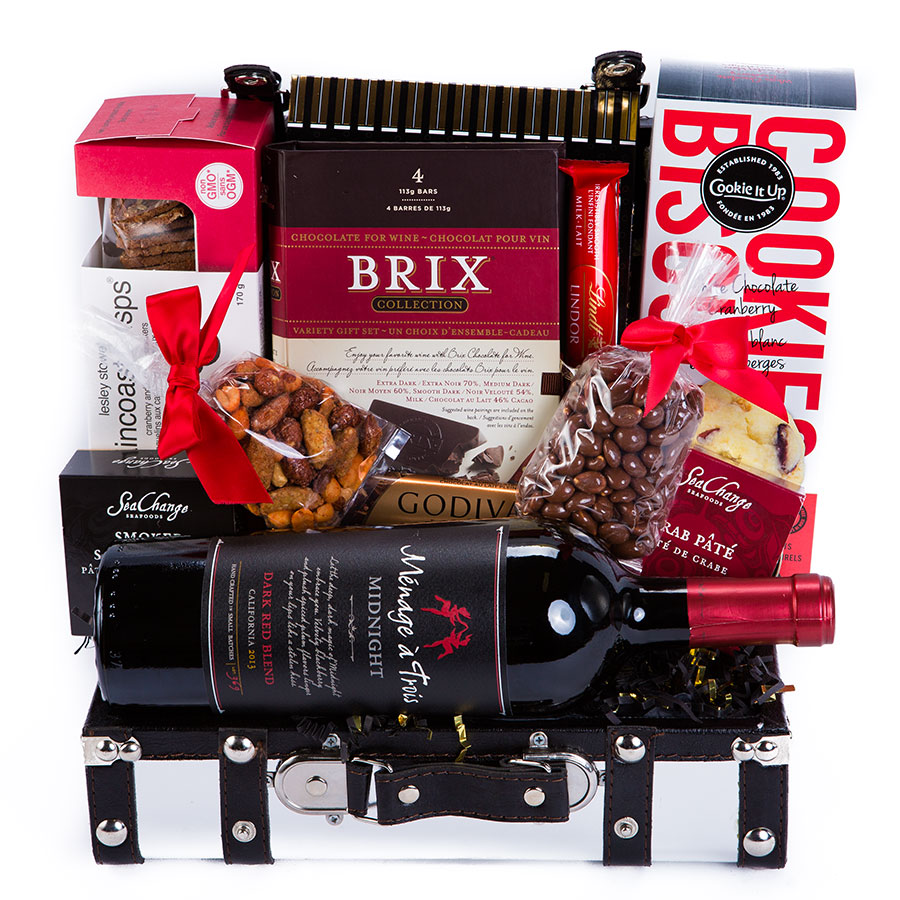 This sterling chest is filled to the brim with tasteful treats, and finished off with a Menage A Trois Midnight Dark Red Blend .  Gift Includes: • Silver Trunk • Menage A Trois Midnight Dark Red Blend • Chocolate Pretzels • Milk Chocolate Peanuts • Brix 4 Piece Collection Gift Set • Lindt Chocolate Stick • White Chocolate Cranberry Shortbread • Lesley Stowes Cranberry Hazelnut Raincoast Crisp Artisan Crackers • Smoked Salmon Pate Tin • Crab Pate • Godiva Milk Chocolate Bar