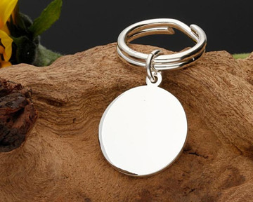Solid Sterling Silver Round Keyring with silver split ring, weight 17g. Laser engraved with your own choice of design or text.