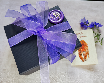 black-luxury-gift-box-with-ribbon-and-card.jpg