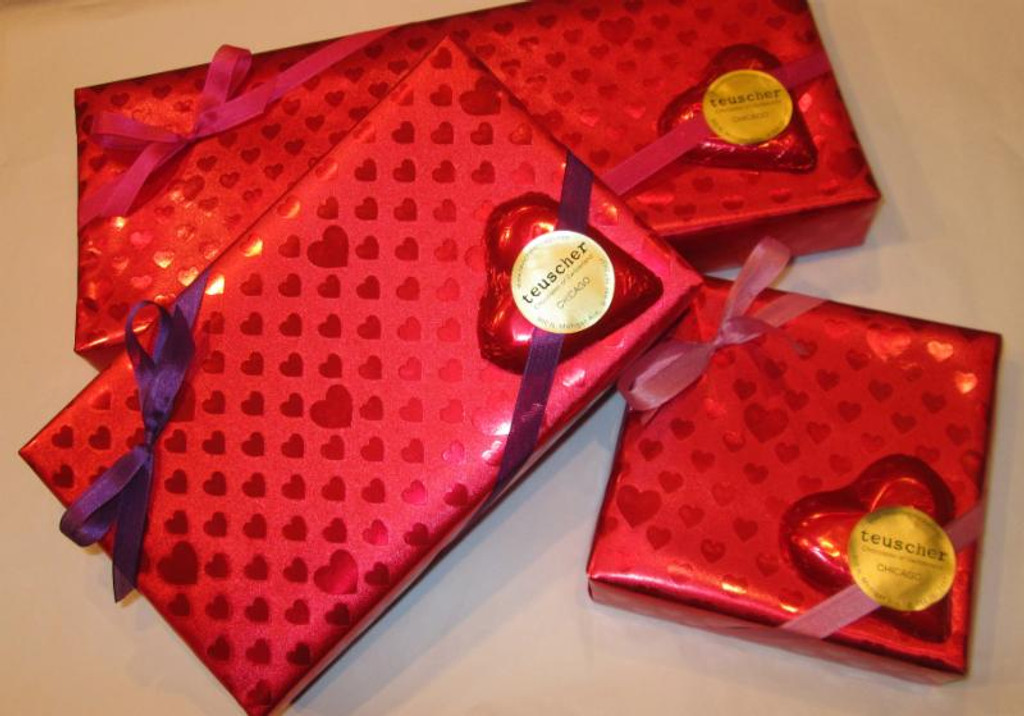 Our Regular Chocolate Truffle Boxes dressed in Valentines wrap with Solid Choc Heart