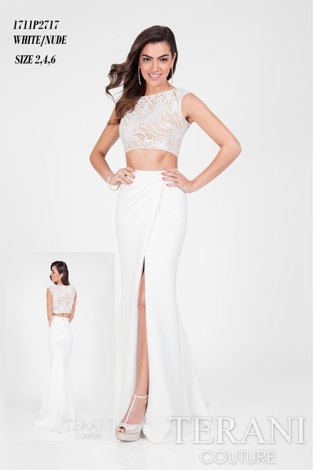 Terani 1711P2717 BEFORE $289.00     NOW $199.00   Prom queen lacy two-piece gown from Terani Prom     Create your collection in an introductory gown from Terani 1711P2717 Prom. The bateau neckline reveals a sleeveless look. Fab embroidery decorates the crop top bodice. The fluted skirt starts high on your waist and drapes in a layered effect to a flared design with a high leg slit and sweep train.  FOR MORE IMFORMATION AND PRICE PLEASE GIVE US A CALL  WE BEAT  ALL PRICES !!!!  VIA MIMI FASHION  1333 S. SANTEE ST.  LA,CA.90015  TEL: (213)748-MIMI (6464)  FAX: (213)749-MIMI (6464)  E-Mail: mimi@viamimifashion.com  https://www.facebook.com/viamimifashion    https://www.instagram.com/viamimifashion