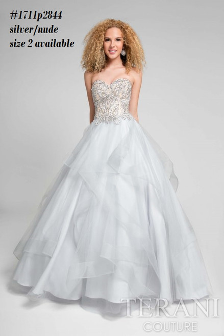 Terani 1711P2844    Debutante sequined layered ballgown from Terani Prom   BEFORE $389.00 NOW $219.00   Capture the essence in a defined gown from Terani 1711P2844 Prom. The strapless sweetheart neckline hugs your bust and leads into a glittering fitted bodice. A wide ballgown skirt is strewn with ruffled layers of fabric in a tiered motif for a voluminous look that ends in a full-length hemlin  FOR MORE IMFORMATION AND PRICE PLEASE GIVE US A CALL  WE BEAT  ALL PRICES !!!!  VIA MIMI FASHION  1333 S. SANTEE ST.  LA,CA.90015  TEL: (213)748-MIMI (6464)  FAX: (213)749-MIMI (6464)  E-Mail: mimi@viamimifashion.com  https://www.facebook.com/viamimifashion    https://www.instagram.com/viamimifashion
