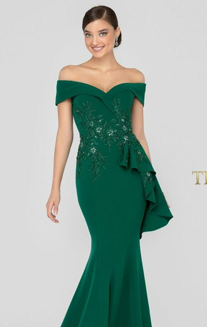 Envelope off-shoulder gown features a beaded floral embellishments covering the front bodice.