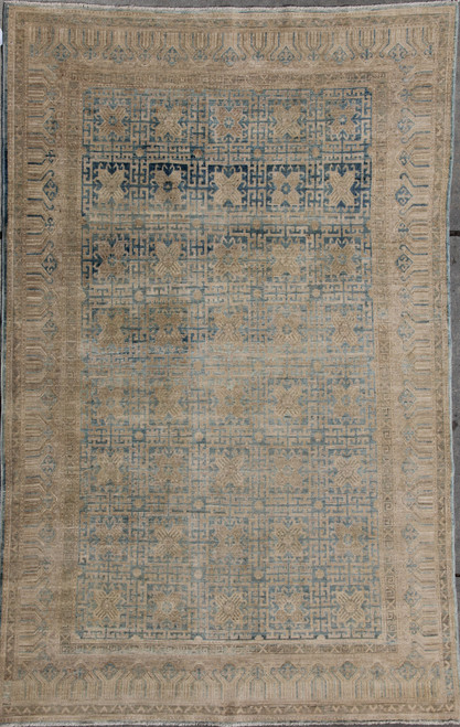 5'11 x 8'9 Beige and light blue rug
