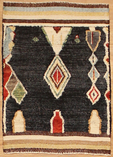 2' x 3' Hand woven wool rug in transitional design woven in India.