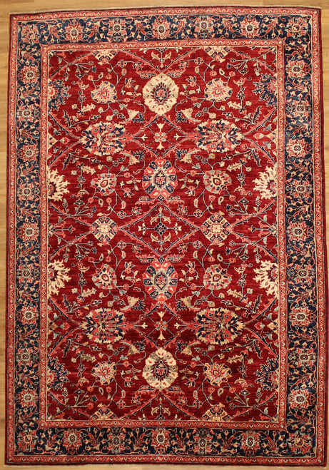 Traditional design red 6' x 8'9 carpet.