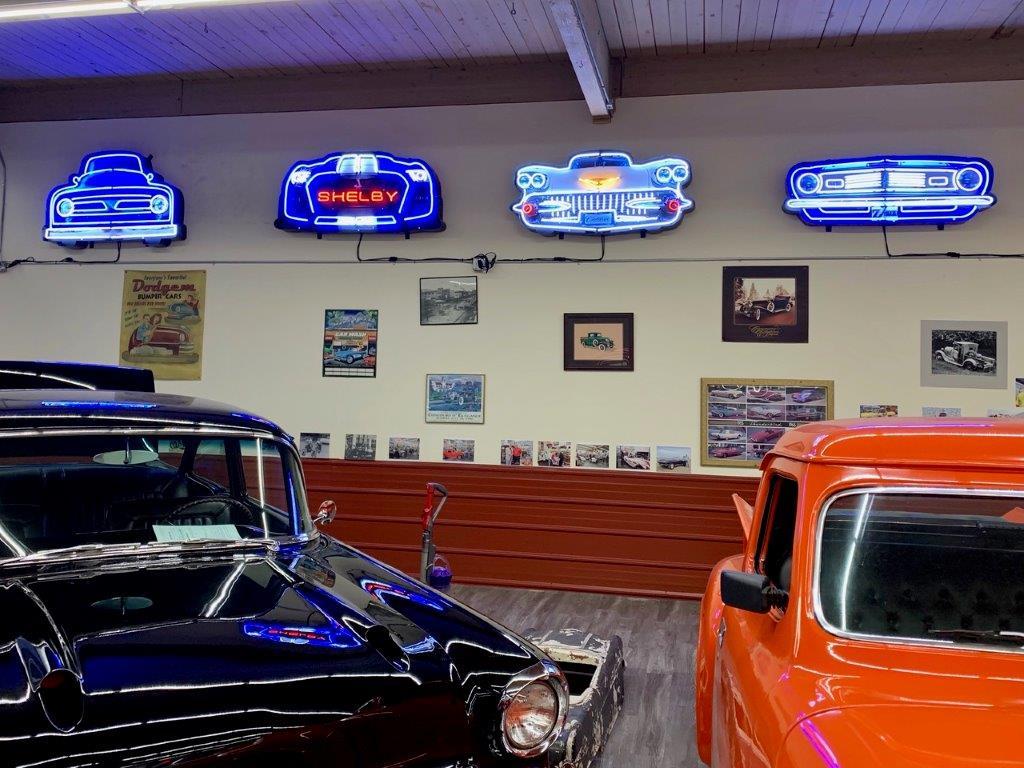 4-of-the-75-pound-neon-grills-in-a-garage.jpg