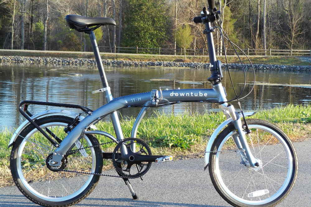 11H folding bike standing in a park