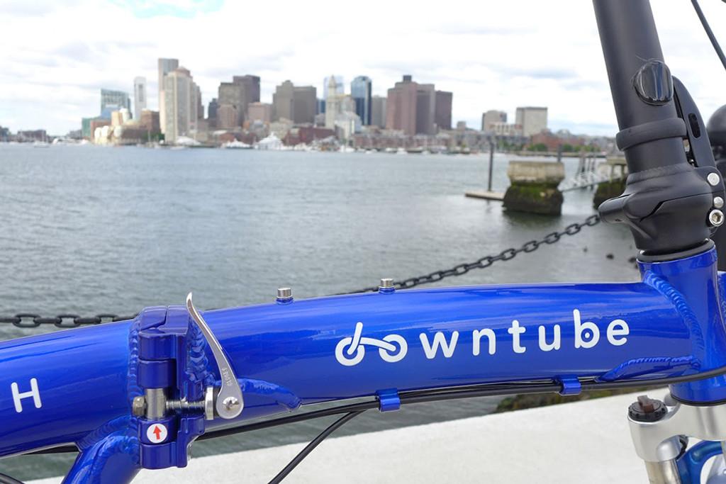 11H city background with a folding bike