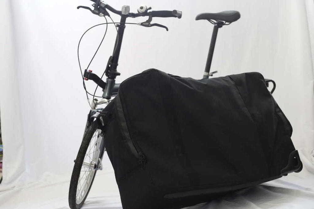 Suitcase next to bike opened up