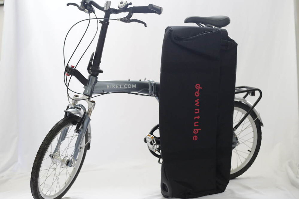 Flat suitcase next to bike
