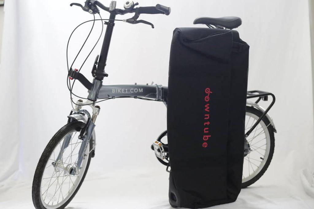 Flat suitcase next to bike