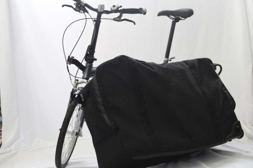 Suitcase next to bike opened up