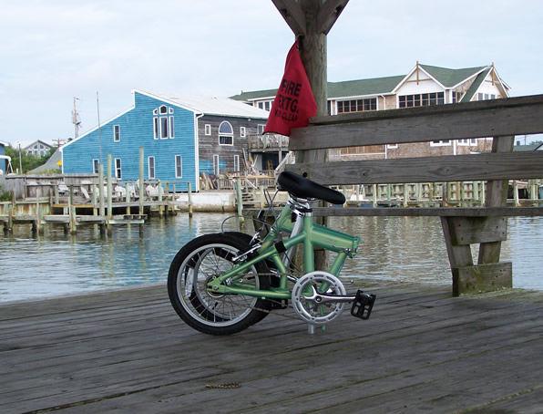 folding bike on docks next to a boat