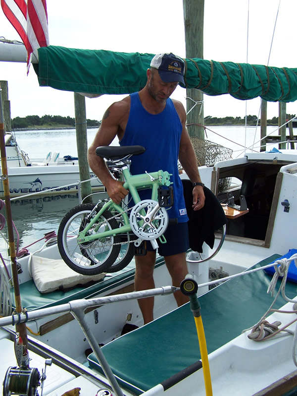 folding bike being carried off a boat