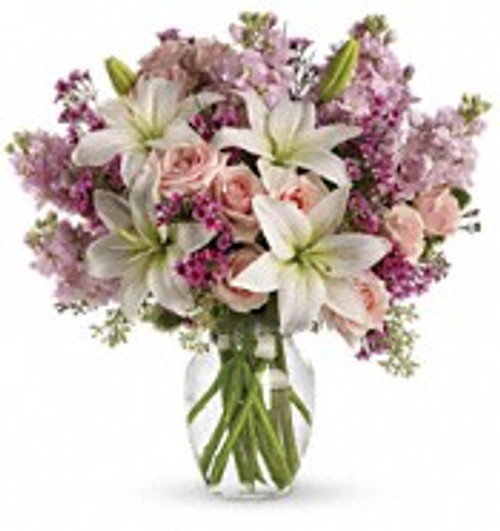 A romantic mixture of fresh flowers in valentine colors of pink, lavender,  and white.
