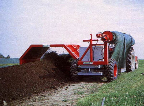 Compost cover roller mounted on turner