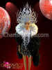 Black mini-dress and boa with white necklace, backpack and headdress