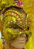 Amber studded Golden sequin mask headdress with yellow layered feathers