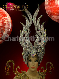 Tall flame-like silver glitter headdress with mirror and sequin accents