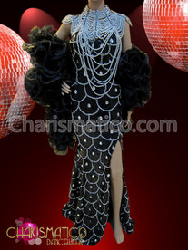 Scale-pattern sequin gown, black organza boa, and silver showgirl's necklace