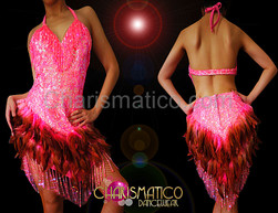 Diva's Coral pink sequined dance dress with feathered skirt accents