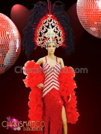 CHARISMATICO Red chevron patterned pageant gown, organza boa and coordinating headdress