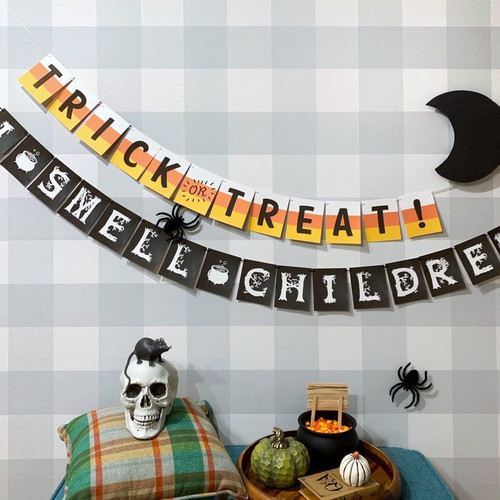 Make your home spooktacular with a fun Halloween paper garland by Earmark!