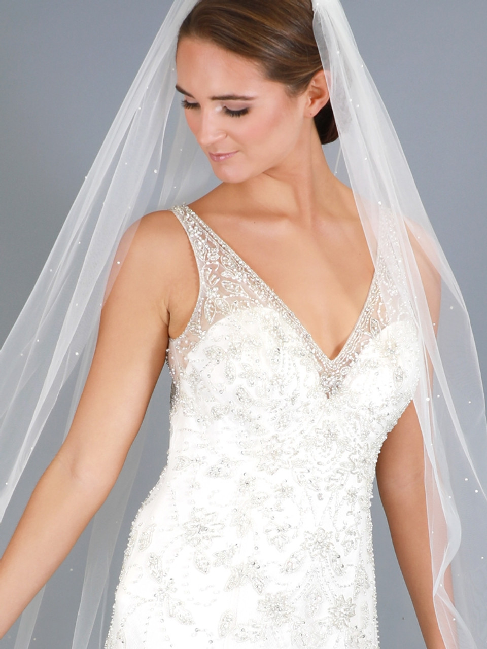 Single Tier Shoulder Length Crystal Cut Edge Bridal Veil Available in white or ivory.