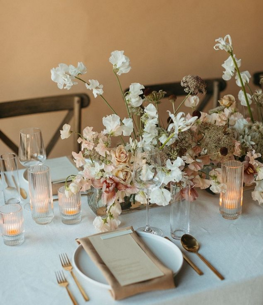 Table Insp: Eggshell colored table with sweet pea and candlelight