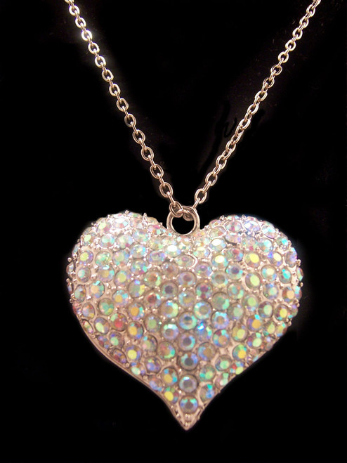 """Rainbow colored heart necklace. Chain is silver in color. Measures 18"""" L. Pendant is 1 5/8"""" H x 1 3/4"""" W.  Pretty, very pretty. Chain is silver in color. Heart pendant is filled with a variety of multicolor rhinestones."""