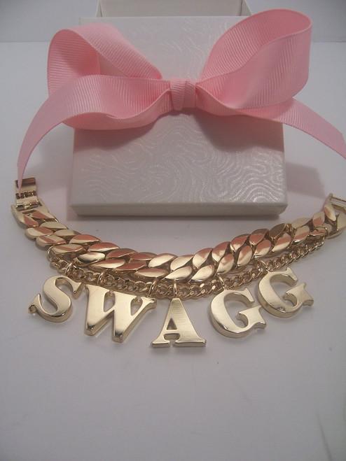 "Gold Tone ""Swagg"" Link Bracelet"