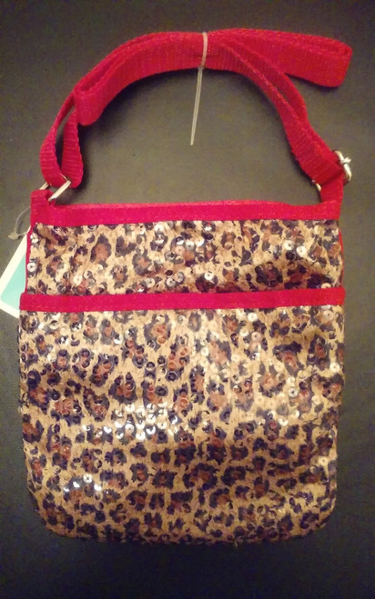 """Your little one will be darling with this fashionable girls leopard print sequin travel crossbody purse. Cute, and affordable too mom!      Features 1 separate zippered pocket for organization in front of purse     Velcro top closure     Adjustable crossbody shoulder strap     Body of bag is, approx. 7.5""""L X 7"""" W.     Adjustable strap"""