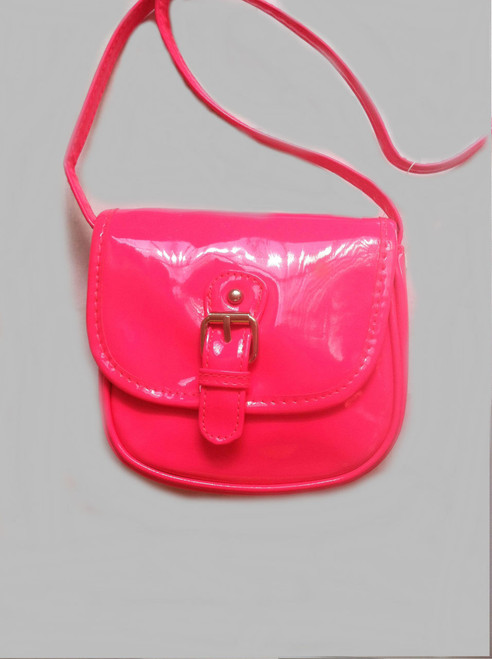 """Your little one will be darling with this fashionable faux patent leather hot pink travel crossbody purse. Cute, and affordable too mom!  Front Buckle  Adjustable crossbody shoulder strap Body of bag is, approx. 6"""" W X 5.5 L Adjustable strap"""